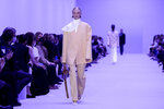 A model wears a creation for the Jil Sander Spring Summer 2022 collection during Milan Fashion Week, in Milan, Italy, Wednesday, Sept. 22, 2021. (AP Photo/Luca Bruno)