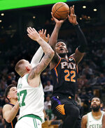 Phoenix Suns center Deandre Ayton (22) shoots over Boston Celtics forward Daniel Theis (27) during the second half of a basketball game in Boston, Wednesday, Dec. 19, 2018. Ayton scored 23 as the Suns defeated the Celtics 111-103. (AP Photo/Charles Krupa)