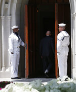 U.S. Naval guard open the door for guests attending a memorial service for Henry Ross Perot at Highland Park United Methodist Church in Dallas, on Tuesday, July 16, 2019. H. Ross Perot, a hard-charging Texan with a folksy manner who made billions in business and twice sought the presidency, was celebrated at the memorial service for his devotion to his family, friends, faith and country. (Vernon Bryant/The Dallas Morning News via AP)