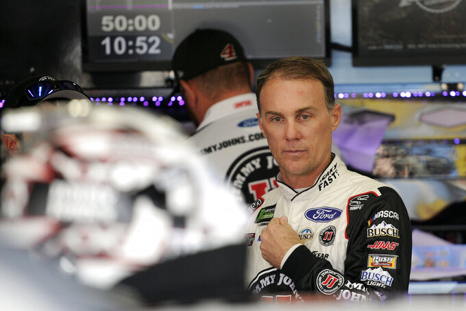 Kevin Harvick waits to practice for Sunday's NASCAR Cup Series auto race at Charlotte Motor Speedway in Concord, N.C., Saturday, Sept. 28, 2019. (AP Photo/Mike McCarn)