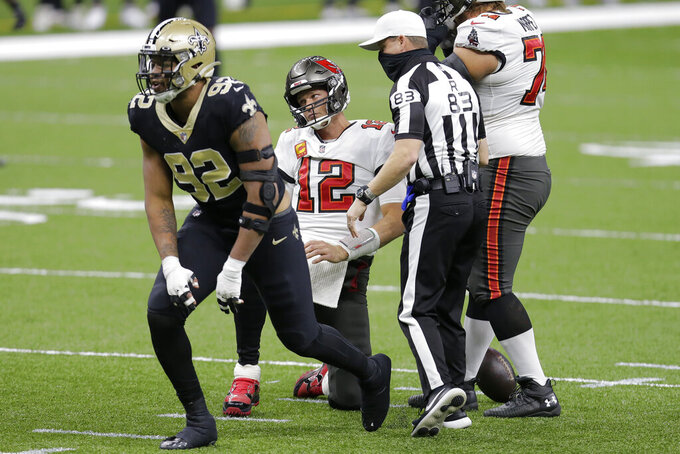New Orleans Saints defensive end Marcus Davenport (92) reacts after sacking Tampa Bay Buccaneers quarterback Tom Brady (12) during the first half of an NFL divisional round playoff football game, Sunday, Jan. 17, 2021, in New Orleans. (AP Photo/Brett Duke)