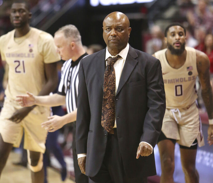 Florida State's head coach Leonard Hamilton, center, reacts to the play in the second half of an NCAA college basketball game with North Carolina State Saturday, March 2, 2019, in Tallahassee, Fla. Florida State won 78-73. (AP Photo/Steve Cannon)