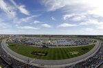 A B-2 Stealth bomber flies by before a NASCAR Cup Series auto race at Kansas Speedway in Kansas City, Kan. Sunday, Oct. 20, 2019. (AP Photo/Charlie Riedel)