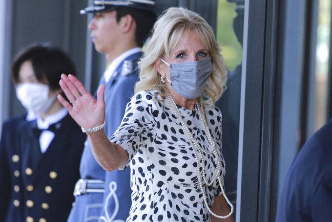 U.S. first lady Jill Biden waves as she arrives at Imperial Palace to meet Japan's Emperor Naruhito in Tokyo, Friday, July 23, 2021. (AP Photo/Koji Sasahara, Pool)