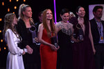 U.S. actress Jessica Chastain, center dressing red, poses with other winners after receiving an ex-aequo Donostia Shell award at the 69th San Sebastian Film Festival, in San Sebastian, northern Spain, Saturday, Sept. 25, 2021. (AP Photo/Alvaro Barrientos)