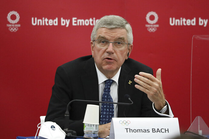 FILE - In this Nov. 16, 2020, file photo, Thomas Bach, International Olympic Committee (IOC) President, speaks during the joint press conference between IOC and Tokyo Organizing Committee of the Olympic and Paralympic Games (Tokyo 2020) in Tokyo, Japan. The International Olympic Committee is pushing back against reports that the postponed Tokyo Olympics will be canceled and will not open on July 23. The Tokyo Games were postponed 10 months ago at the outbreak of the coronavirus pandemic, and now their future appears threatened again.(Du Xiaoyi/Pool Photo via AP, File)