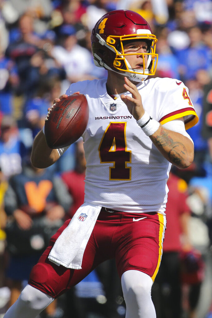 Washington Football Team quarterback Taylor Heinicke (4) throws a pass during the first half of an NFL football game against the Buffalo Bills on Sunday, Sept. 26, 2021, in Orchard Park, N.Y. (AP Photo/Jeffrey T. Barnes)