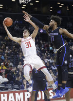 Davidson's Kellan Grady (31) drives past Saint Louis' Hasahn French (11) during the first half of an NCAA college basketball game in the semifinal round of the Atlantic 10 men's tournament Saturday, March 16, 2019, in New York. (AP Photo/Frank Franklin II)