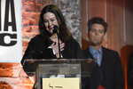 """Fiona Prine, the widow of the late John Prine, accepts the song of the year award presented for John Prine's song """"I Remember Everything"""" at the Americana Honors & Awards show Wednesday, Sept. 22, 2021, in Nashville, Tenn. (AP Photo/Mark Zaleski)"""