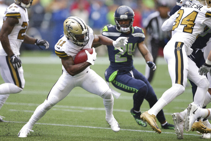 New Orleans Saints' Deonte Harris (11) carries on a punt return as Seattle Seahawks' Jamar Taylor moves in during the first half of an NFL football game, Sunday, Sept. 22, 2019, in Seattle. (AP Photo/Scott Eklund)