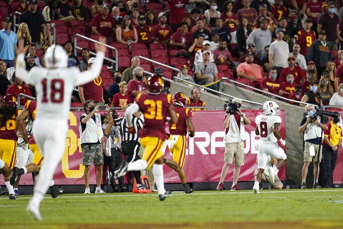 Stanford running back Nathaniel Peat (8) runs for a touchdown during the first half of the team's NCAA college football game against Southern California on Saturday, Sept. 11, 2021, in Los Angeles. (AP Photo/Marcio Jose Sanchez)