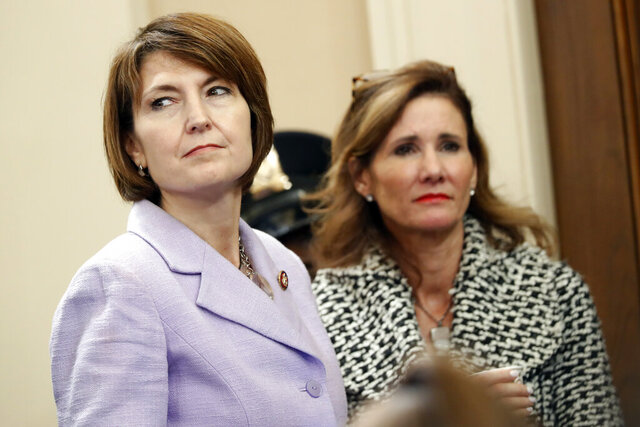 Rep. Cathy McMorris Rodgers, R-Wash., listens as former White House national security aide Fiona Hill, and David Holmes, a U.S. diplomat in Ukraine, testify before the House Intelligence Committee on Capitol Hill in Washington, Thursday, Nov. 21, 2019, during a public impeachment hearing of President Donald Trump's efforts to tie U.S. aid for Ukraine to investigations of his political opponents. (AP Photo/Andrew Harnik)
