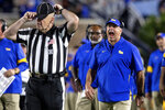 Pittsburgh coach Pat Narduzzi, right, shouts at an official after a play during the team's NCAA college football game against Duke in Durham, N.C., Saturday, Oct. 5, 2019. (AP Photo/Ben McKeown)