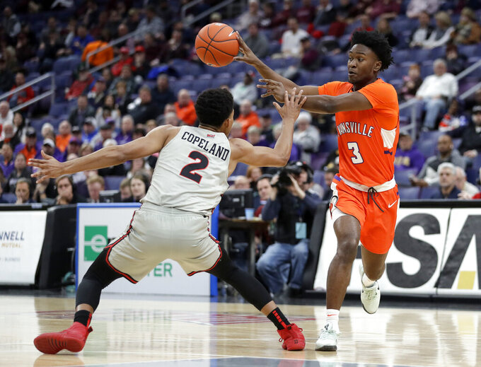 Evansville's Jawaun Newton (3) passes the ball past Illinois State's Zach Copeland (2) during the first half of an NCAA college basketball game in the first round of the Missouri Valley Conference men's tournament Thursday, March 7, 2019, in St. Louis. (AP Photo/Jeff Roberson)