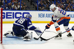 Tampa Bay Lightning goaltender Andrei Vasilevskiy (88) tracks a shot by New York Islanders center Brock Nelson (29) during the third period in Game 2 of an NHL hockey Stanley Cup semifinal playoff series Tuesday, June 15, 2021, in Tampa, Fla. (AP Photo/Chris O'Meara)