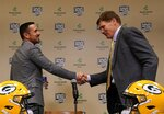 Green Bay Packers President and CEO Mark Murphy shakes hands with head coach Matt LaFleur at a news conference Wednesday, Jan. 9, 2019, in Green Bay, Wis. (AP Photo/Morry Gash)
