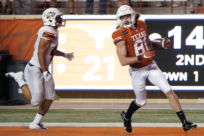 Texas's Cade Brewer (80) runs into the end zone for a touchdown against UTEP during the first half of an NCAA college football game in Austin, Texas, Saturday, Sept. 12, 2020. (AP Photo/Chuck Burton)
