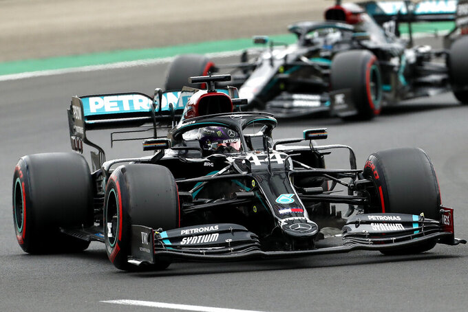 Mercedes driver Lewis Hamilton of Britain leads his teammate Mercedes driver Valtteri Bottas of Finland during the qualifying session for the Hungarian Formula One Grand Prix at the Hungaroring racetrack in Mogyorod, Hungary, Saturday, July 18, 2020. The Hungarian F1 Grand Prix will be held on Sunday. (Darko Bandic/Pool)