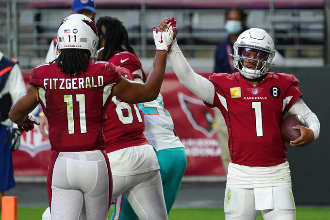 Arizona Cardinals quarterback Kyler Murray (1) high fives wide receiver Larry Fitzgerald (11) after scoring a touchdown against the Miami Dolphins during the second half of an NFL football game, Sunday, Nov. 8, 2020, in Glendale, Ariz. (AP Photo/Rick Scuteri)