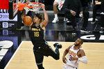Memphis Grizzlies forward Brandon Clarke (15) dunks ahead of Phoenix Suns guard Chris Paul (3) in the first half of an NBA basketball game Monday, Jan. 18, 2021, in Memphis, Tenn. (AP Photo/Brandon Dill)