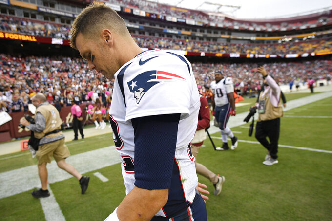 New England Patriots quarterback Tom Brady leaves the field after an an NFL football game against the Washington Redskins, Sunday, Oct. 6, 2019, in Washington. The New England Patriots won 33-7. (AP Photo/Nick Wass)