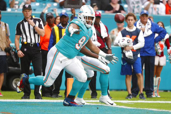 Miami Dolphins defensive tackle Christian Wilkins (94) goes after the football after the fumbles and recovered it for a touchdown, during the first half at an NFL football game ab=, Sunday, Dec. 22, 2019, in Miami Gardens, Fla. (AP Photo/Wilfredo Lee)