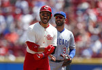 Cincinnati Reds' Eugenio Suarez, left, reacts after being tagged out by Chicago Cubs second baseman Daniel Descalso, right, turning to third on a double, during the sixth inning of a baseball game, Sunday, June 30, 2019, in Cincinnati. (AP Photo/Gary Landers)
