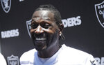 Oakland Raiders wide receiver Antonio Brown speaks to reporters after NFL football practice at the team's headquarters in Alameda, Calif., Tuesday, May 28, 2019. (AP Photo/Jeff Chiu)