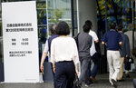 Shareholders enter a conference hall to attend Nissan's general meeting of shareholders in Yokohama, near Tokyo, Tuesday, June 25, 2019. Japanese automaker Nissan faces shareholders as profits and sales tumble after its former star chairman faces trial on financial misconduct allegations. (AP Photo/Koji Sasahara)