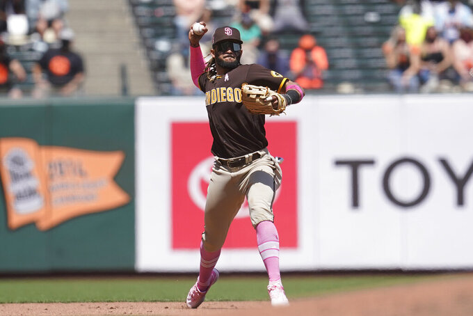 San Diego Padres shortstop Fernando Tatis Jr. throws out San Francisco Giants' Austin Slater at first base during the fifth inning of a baseball game in San Francisco, Sunday, May 9, 2021. (AP Photo/Jeff Chiu)