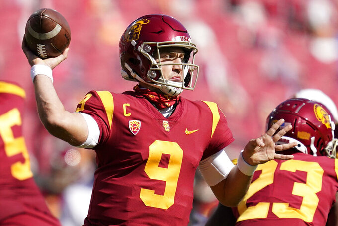 Southern California quarterback Kedon Slovis (9) throws a pass during the second half of an NCAA college football game against Arizona State, Saturday, Nov. 7, 2020, in Los Angeles. (AP Photo/Ashley Landis)