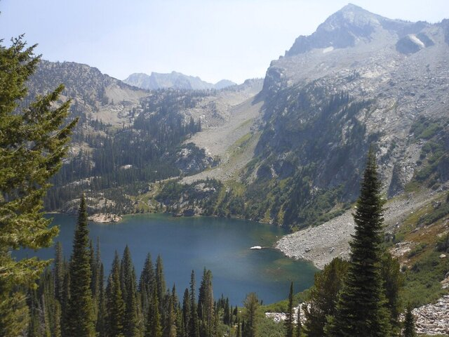 FILE - This Aug. 23, 2015, file photo shows Alpine Lake in the Sawtooth National Forest, south of Stanley, Idaho. U.S. officials have permanently closed four sheep and goat grazing allotments in and near central Idaho wilderness areas, including the Sawtooth National Forest, that are important habitat for wolves, bighorn sheep and other wildlife. (Mark Morical/The Bulletin via AP, File)