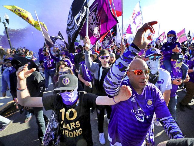 Fans march together into Exploria Stadium ahead of the MLS soccer season opener for Orlando City, in Orlando, Fla., Saturday, Feb. 29, 2020. Orlando City SC take on Real Salt Lake. (Joe Burbank/Orlando Sentinel via AP)