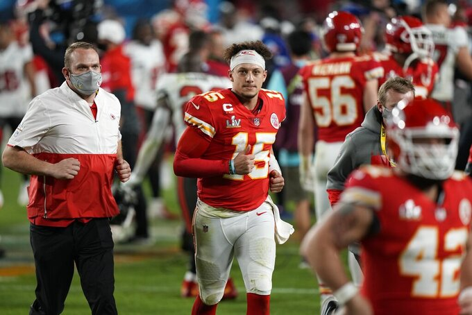 Kansas City Chiefs quarterback Patrick Mahomes runs off the field after the NFL Super Bowl 55 football game Sunday, Feb. 7, 2021, in Tampa, Fla. The Buccaneers defeated the Chiefs 31-9 to win the Super Bowl. (AP Photo/David J. Phillip)