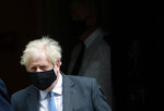 Britain's Prime Minister Boris Johnson leaves 10 Downing Street to attend the weekly Prime Minister's' Questions session in parliament in London, Wednesday, April 28, 2021. (AP Photo/Frank Augstein)