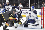 Vegas Golden Knights right wing Reilly Smith (19) shoots against Winnipeg Jets goaltender Laurent Brossoit during the second period of an NHL hockey game Saturday, Nov. 2, 2019, in Las Vegas. (AP Photo/David Becker)