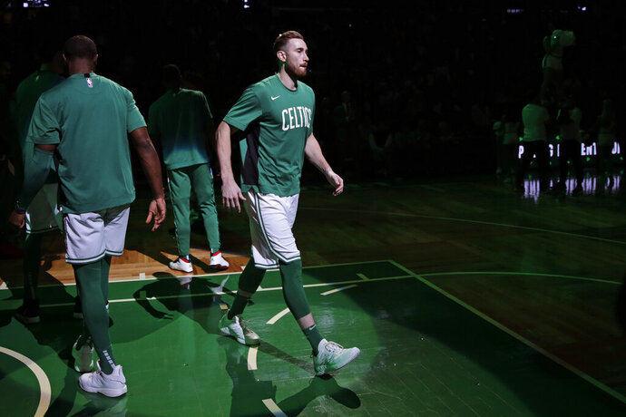 Boston Celtics forward Gordon Hayward is introduced in the starting line up prior to the first half of an NBA basketball game against the Cleveland Cavaliers in Boston, Monday, Dec. 9, 2019. Hayward returned to play after breaking his left hand in early November. (AP Photo/Charles Krupa)