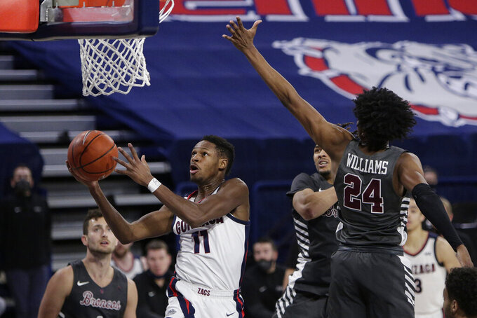 Gonzaga guard Joel Ayayi (11) shoots in front of Santa Clara guard Jalen Williams (24) during the second half of an NCAA college basketball game in Spokane, Wash., Thursday, Feb. 25, 2021. (AP Photo/Young Kwak)