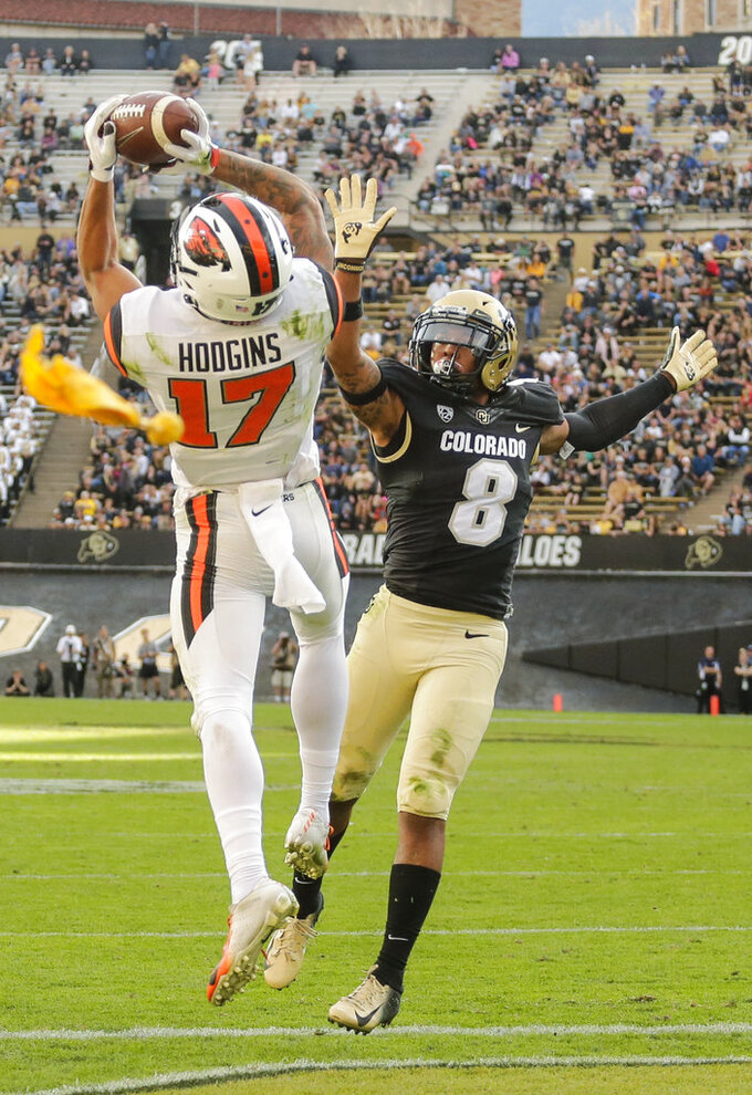 Oregon State wide receiver Isaiah Hodgins (17) catches a pass for an extra point conversion against Colorado defensive back Trey Udoffia (8) during the second half of an NCAA college football game, Saturday, Oct. 27, 2018, in Boulder, Colo. (AP Photo/Jack Dempsey)