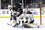 Buffalo Sabres goaltender Carter Hutton, right, stops a shot next to Los Angeles Kings' Ilya Kovalchuk (17) during the second period of an NHL hockey game Thursday, Oct. 17, 2019, in Los Angeles. (AP Photo/Marcio Jose Sanchez)