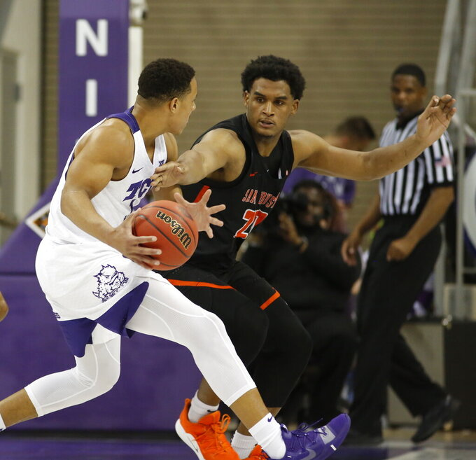 TCU guard Desmond Bane (1) is defended by Sam Houston State forward Kai Mitchell (20) during the first half of an NCAA college basketball game in the NIT on Wednesday, March 20, 2019, in Fort Worth, Texas. (David Kent/Star-Telegram via AP)