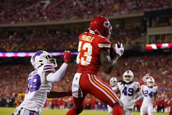 Kansas City Chiefs wide receiver Byron Pringle (13) catches a touchdown pass as Buffalo Bills cornerback Levi Wallace (39) defends during the first half of an NFL football game Sunday, Oct. 10, 2021, in Kansas City, Mo. (AP Photo/Charlie Riedel)