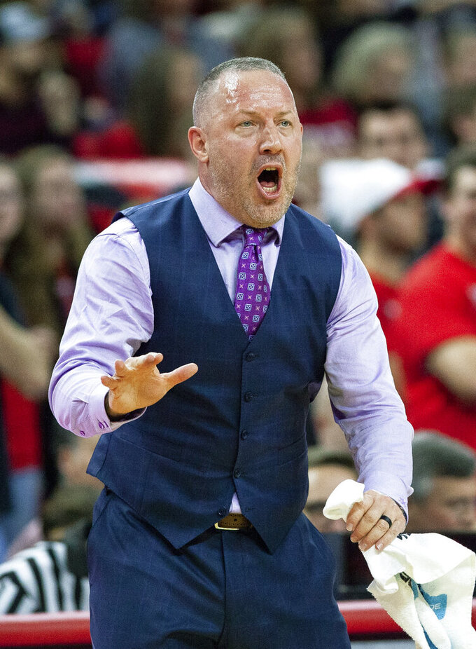 Virginia Tech Head Coach Buzz Williams directs his team during the first half of an NCAA college basketball game against North Carolina State in Raleigh, N.C., Saturday, Feb. 2, 2019. (AP Photo/Ben McKeown)