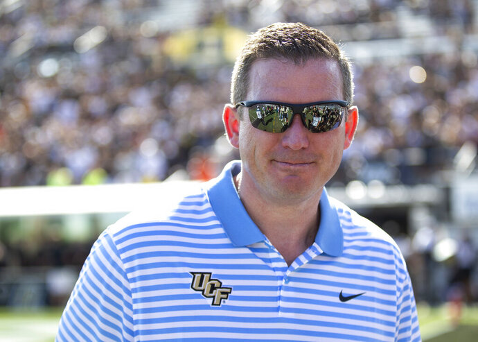 FILE - In this Nov. 2, 2019, file photo, Central Florida athletic director Danny White stands on the sideline at the team's NCAA college football game against Houston in Orlando, Fla. Tennessee has hired UCF athletic director Danny White as the Volunteers' new athletic director Thursday, Jan. 21, 2021, just three days after announcing the firing of football coach Jeremy Pruitt and athletic director Phillip Fulmer's retirement. (AP Photo/Willie J. Allen Jr., File)