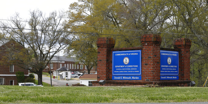 File-This Wednesday April 1, 2020 file photo shows The Correctional Center for Women where several women have tested positive for COVID-19 at the facility in Goochland, Va. (AP Photo/Steve Helber, File)