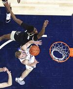 Virginia forward Sam Hauser, bottom, shoots against Wake Forest's Isaiah Mucius during an NCAA college basketball game Wednesday, Jan. 6, 2021, in Charlottesville, Va. (Erin Edgerton/The Daily Progress via AP, Pool)