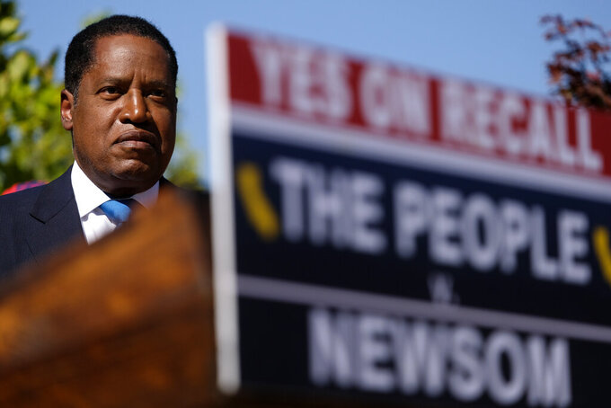 Republican conservative radio show host Larry Elder attends a rally for the California gubernatorial recall election on Monday, Sept. 13, 2021, in Monterey Park, Calif. (AP Photo/Ringo H.W. Chiu)