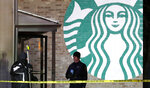Personnel work at the scene in McHenry, Ill. where a vehicle drove into the Starbucks Thursday, Jan. 16, 2020. (Patrick Kunzer/Daily Herald via AP)