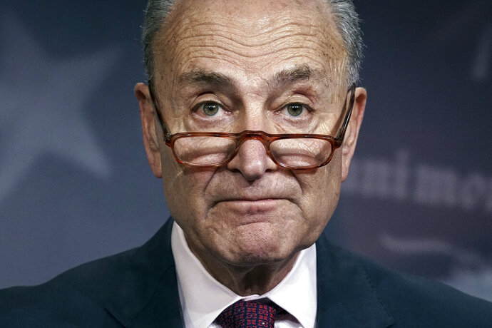 """FILE - In this Monday, Dec. 9, 2019, file photo, Senate Minority Leader Chuck Schumer, D-N.Y., speaks to reporters on Capitol Hill in Washington. Senate Democrats are proposing a weekslong Senate impeachment trial seeking testimony from four new witnesses including John Bolton and Mick Mulvaney over President Donald Trump's actions toward Ukraine, according to a detailed outlined released Sunday, Dec. 15. Schumer proposed the structure for a """"fair and honest'' trial in a letter to Majority Leader Mitch McConnell. (AP Photo/J. Scott Applewhite, File)"""