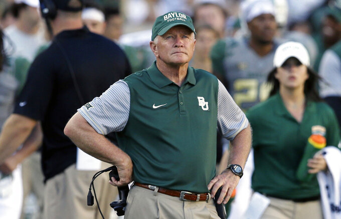 FILE - In this Sept. 10, 2016, file photo, Baylor acting coach Jim Grobe watches from the sideline during the second half of the team's NCAA college football game against SMU in Waco, Texas. Grobe, a former Wake Forest coach, came out of retirement to lead Baylor after Art Briles was fired following a sexual abuse scandal at the school. Grobe led the team to a 6-6 regular-season finish and a spot in the Cactus Bowl. The Bears defeated favored Boise State 31-12 to give the Bears a winning season. Grobe steadfastly said he had no interest in returning for another year and he headed back into retirement. (AP Photo/LM Otero, File)